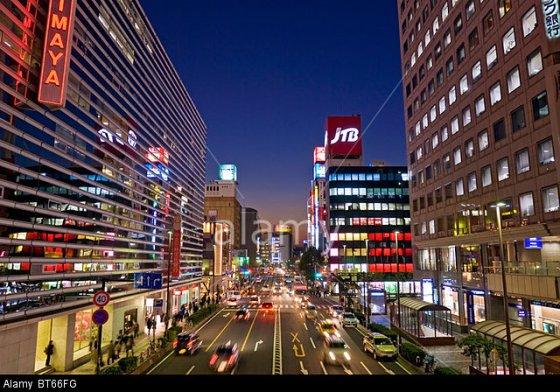 Busy Asian city street in Yokohama, Japan at night.
